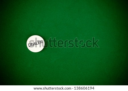 Chip dealer on poker green table - stock photo