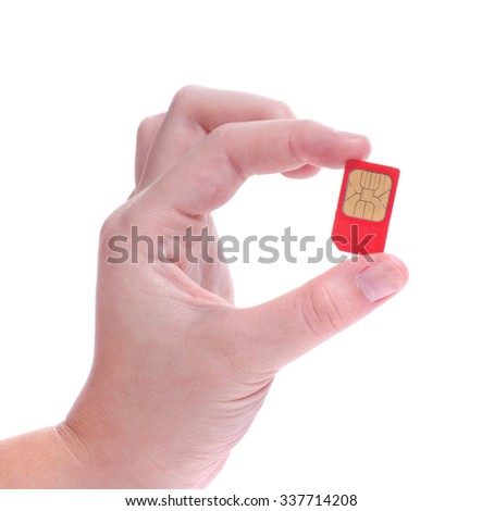 Chip gsm mobile phone in hand - stock photo