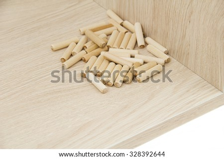 Chipboard with wooden pin - stock photo