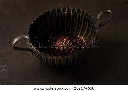 chipotle - jalapeno smoked chili flakes in small tin on metal background - stock photo