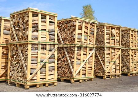 Chipped fire wood in packing on pallets - stock photo