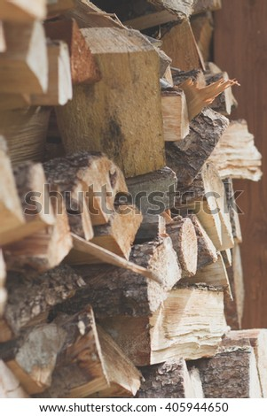 chipped firewood in shed - stock photo