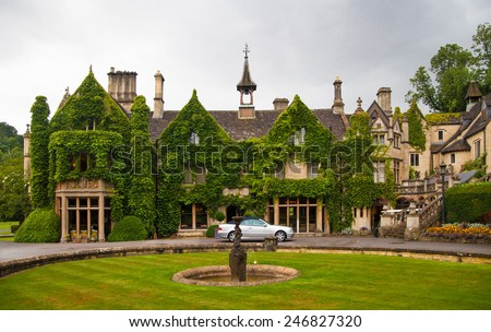 CHIPPENHAM, UK - AUGUST 9, 2014: Castle Combe park and old house. Mansion of very reach people 19th century