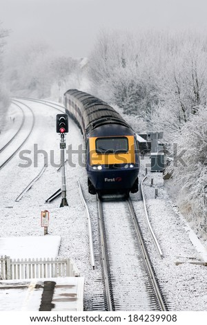 CHIPPENHAM, UK - JANUARY 9: A First Great Western HST 125 (Intercity 125 train) arrives at Chippenham station as winter storms cross the UK on January 9, 2009 in Chippenham, UK.   - stock photo
