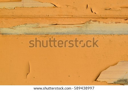 Chipping paint of old wooden wall.