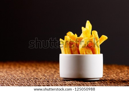 Chips, also known as French Fries are more British than French - stock photo