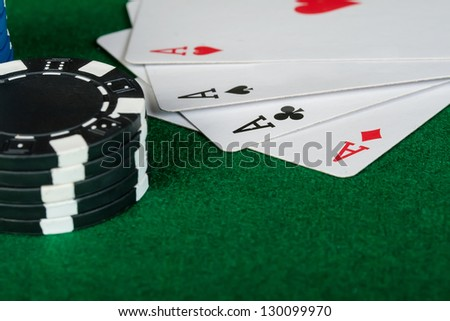 Chips and cards for the poker on the table. - stock photo