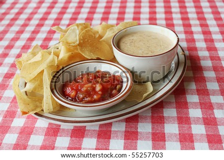 Chips and salsa on tablecloth