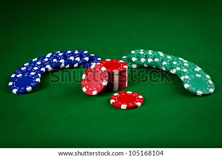 chips for poker on green playing table