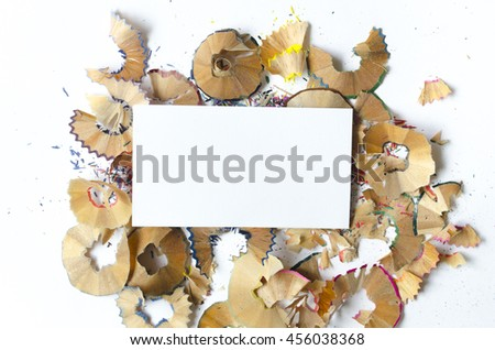 Chips from colored pencils, business card mock up - stock photo