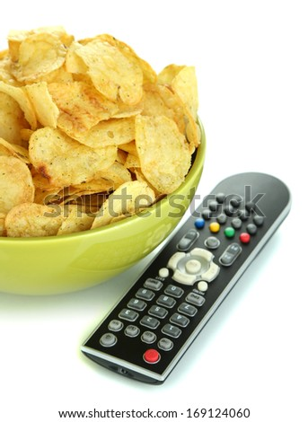 Chips in bowl and TV remote isolated on white - stock photo