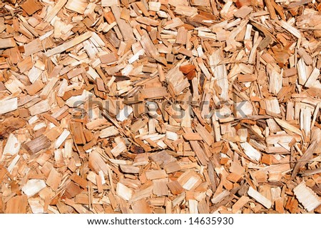 Chips of orange cypress mulch for background use - stock photo
