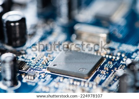 Chips on a blue PCB (detailed close-up shot)