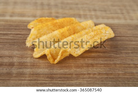 chips on a wooden table
