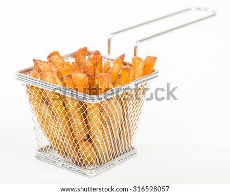 Chips - Spicy fries in a individual metal basket.