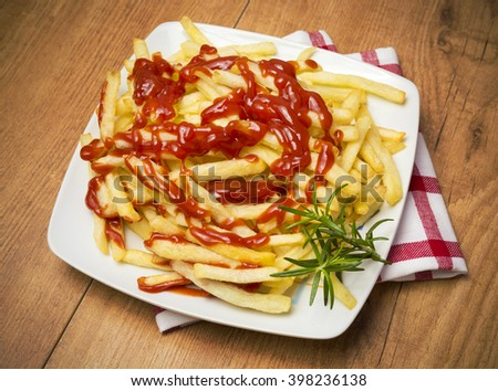 Chips with ketchup - stock photo