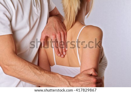 Chiropractic, osteopathy. Therapist  doing healing treatment on woman's back . Alternative medicine, pain relief concept
