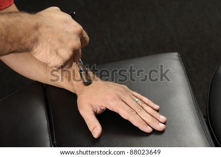 Chiropractor adjusting wrist bone - stock photo