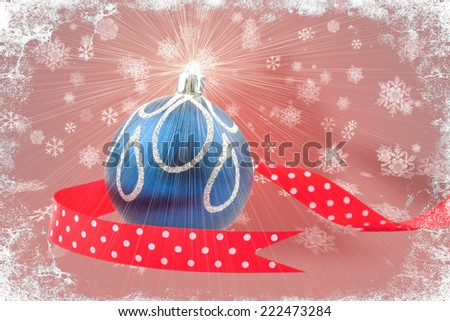 Chirstmas bauble with red ribbon on bokeh background with snowflakes - stock photo