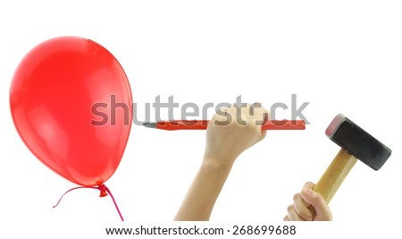 Chisel and hammer about to pop a balloon isolated on white - stock photo