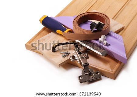 Chisel, the door to the cabinet hinge, bolts, and handle, drill, edge for gluing the ends - stock photo
