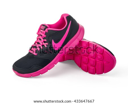 Chisinau, Moldova- May 27, 2015: Nike lady's - women's running shoes - sneakers - trainers, in gray and pink, showing the Nike swoosh logo and sole - illustrative editorial