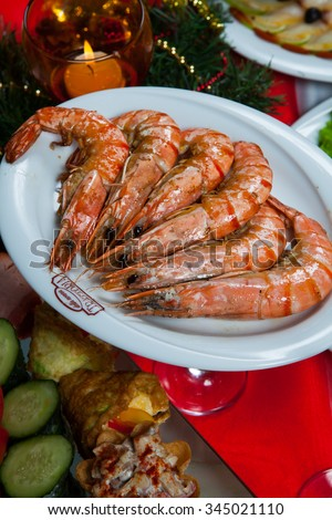 Chisinau, Moldova - November 25, 2015: Pile of prepared shrimps on the plate. Pile of big king red cooked prawns. King Shrimps. November 25, 2015 in Chisinau, Moldova.