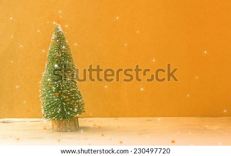 Chistmas tree,on wooden background,filter color editing. - stock photo