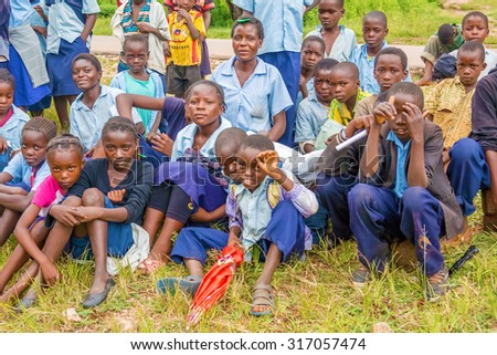 Chitizauwe, Zambia - April 1, 2015: Group of young boys and girls in a small village of Chitizauwe in Zambia