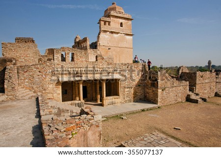 CHITTORGARH, INDIA - FEB 15: Tourists watching towers in maze of the largest fort in Rajasthan, UNESCO World Heritage Site on February 15, 2015. Chitaurgarh has population about 117,000