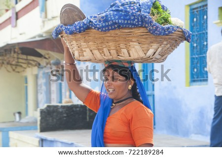CHITTORGARH, RAJASTHAN, INDIA, 4 NOVEMBER 2015 : Unidentified woman street vendor selling vegetables on the street of village.