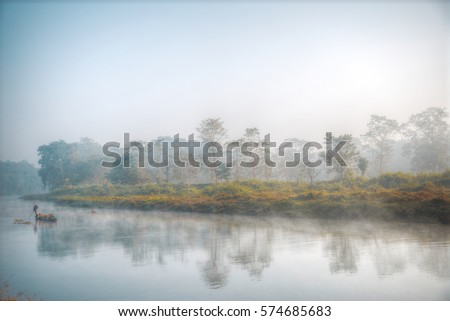 Chitwan National Park.  is mainly covered by jungle. canoeing on the river