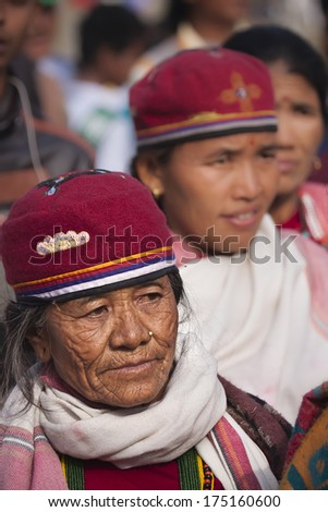 Chitwan, Nepal- December 26, 2013: Portrait of old woman wearing tradtional hat for a Cultural program during elephant festival, Chitwan 2013, Nepal