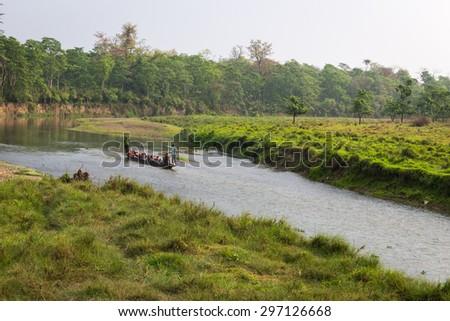 CHITWAN, NEPAL-MARCH 27: Boat safari 27, 2015 in Chitwan, Nepal. Ð¡anoe safari in the Chitwan National Park., INDIA- - stock photo