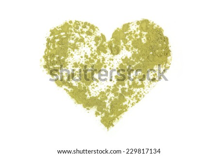 Chlorella, spirulina and wheat grass ground powder forming heart shape. Detox, healthy living, alternative medicine. - stock photo
