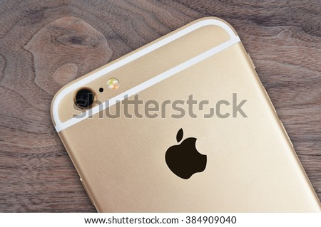 CHLUMCANY, CZECH REPUBLIC, FEBRUARY 28. 2016: Rear view of iPhone 6s on wooden background - stock photo