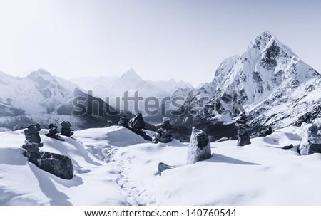 Cho La pass and stone stacks at sunrise in Himalaya. Travel to Nepal - stock photo
