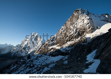 Cho La pass peaks at dawn in Himalaya mountains. Hiling in Nepal - stock photo
