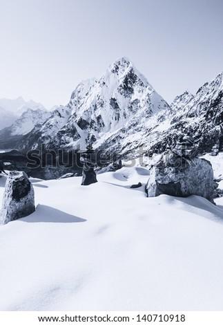 Cho La pass peaks at dawn in Himalaya mountains. Trekking in Nepal - stock photo