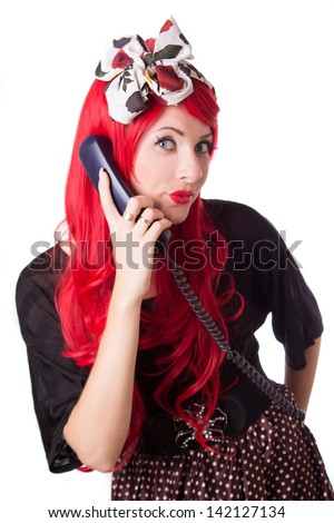 Chocked retro woman with red hair on the phone isolated on white