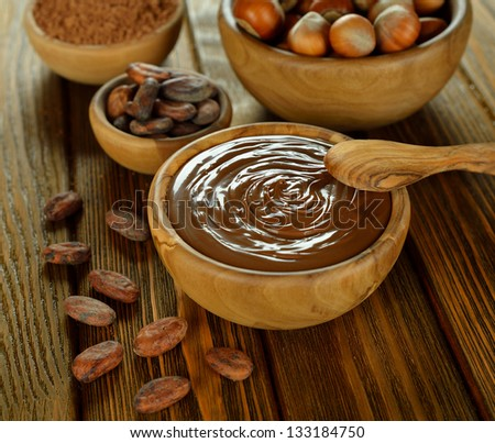 Chocolate and cocoa beans on a brown table