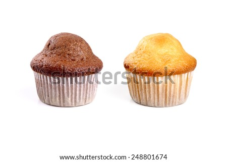 Chocolate and cream muffins on white background - stock photo