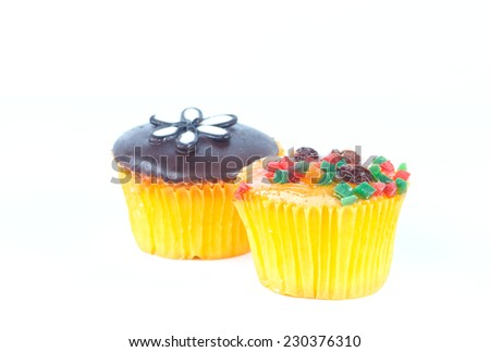 chocolate and fruit cupcake on white background