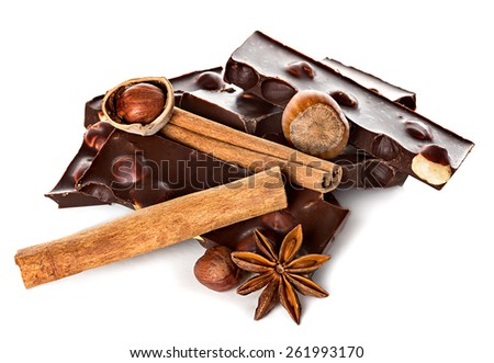 Chocolate and nuts with cinnamon sticks, star anise isolated - stock photo