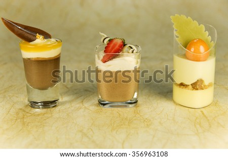 Chocolate and Orange Mousse Deserts In Glasses - stock photo