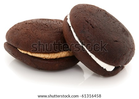 Chocolate And Peanut Butter Whoopie Pies Shot On White Background - stock photo