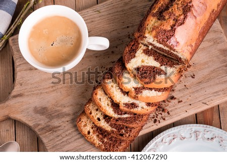 Chocolate and Vanilla Gluten free Marble Cake, made in a loaf pan served with coffee. Homemade  Pound Cake. - stock photo