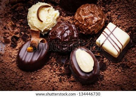 chocolate background with pralines - stock photo