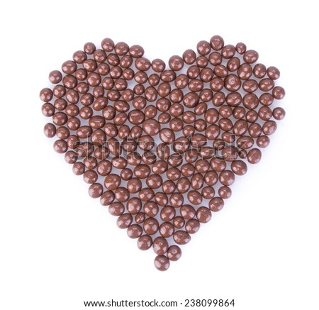 chocolate balls. chocolate balls in love shape on a background. - stock photo