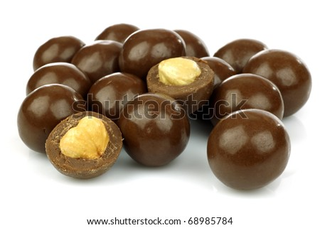 chocolate balls filled with hazelnuts on a white background